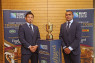 SPORTJapan rugby team vice-captain Ayumu Goromaru (left) and captain Michael Leitch are pictured with the Webb Ellis Cup in the office of Prime Minister Shinzo Abe on 26 May. Photo: ©JRFU 2014, H. Nagaoka.