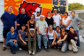 Former BCCJ President Philip T Gibb (top left) and BCCJ Executive Director Lori Henderson (bottom, fourth from right) with other volunteers in the BCCJ's container painting project. It is part of their Back to Business (B2B) Initiative for Tohoku, held in Ishinomaki, Miyagi Prefecture, on 29-30 September.
