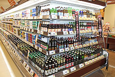 By selling imported beers not available in convenience stores, supermarkets have seen increased beersales.
