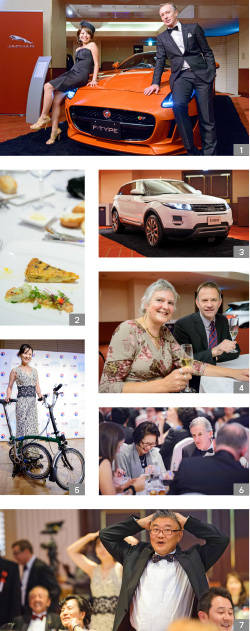 1. Masters of ceremonies Madoka Kato and Guy Perryman. 2. The event featured British-themed cuisine. 3. 	A Land Rover was on display. 4. 	Volunteer Jane Best OBE played a key part in the event. 5. 	A Brompton bicycle was one of the evening's keenly contested prizes. 6. 	Guests enjoyed a six-course meal with wine pairings. 7. 	Guests took part in a game of heads and tails to win the bicycle pictured.
