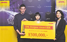 Steven Hall and Yurika Ohara (centre) received the award from Junko Takata of DHL.