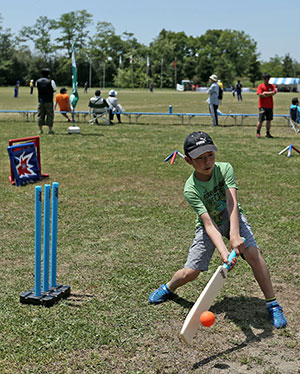 Children learn the basics of cricket.