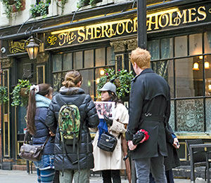 Japanese tour guide Miki Bartley explains the British character Sherlock Holmes.