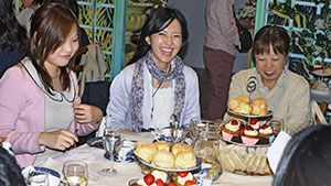 Japanese tourists enjoy afternoon tea in the Lake District.