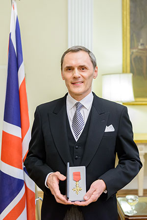 Philippe Fauchet, president and representative director of GSK, with his Honorary OBE