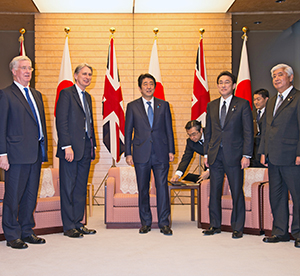 Prime Minister Shinzo Abe (centre) met (from left) ministers Michael Fallon, Philip Hammond, Fumio Kishida and Gen Nakatani