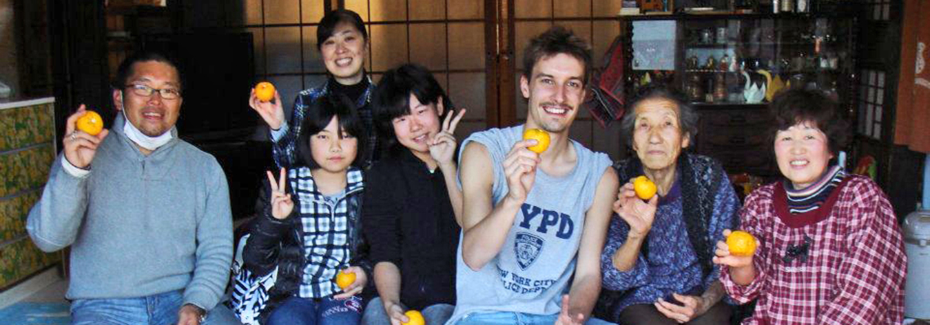 Jack Brooks (centre) picked fruit with locals in Saitama Prefecture.