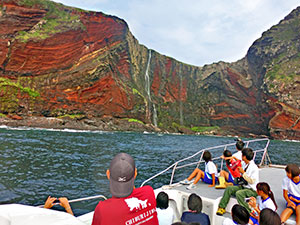 Visitors take a tour incorporating the Sekiheki Red Cliff.